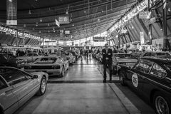 Different cars in the exhibition hall. Stock Photo