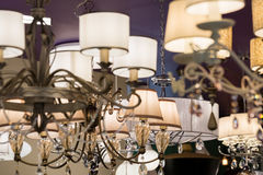 Different chandeliers in a lighting shop Stock Image