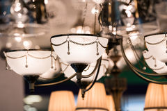 Different chandeliers in a lighting shop Stock Photo