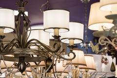 Different chandeliers in a lighting shop Stock Photography
