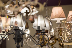 Different chandeliers in a lighting shop Royalty Free Stock Images