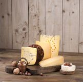Different cheese classic choice, on an old wooden board and nuts. Different cheese classic choice, on an old wooden board and nuts Royalty Free Stock Image