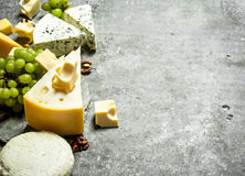 Different cheese , grapes and nuts. Stock Photo