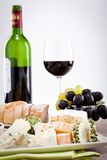 Cheese plate with grapes and wine dinner Royalty Free Stock Images