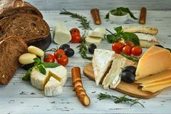 Different cheeses on table. Fresh dairy products royalty free stock photography