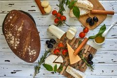 Different cheeses on table. Fresh dairy products royalty free stock photos