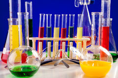 Different Chemistry lab set on a table over blue background Stock Image