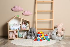 Different child toys on floor. Against color wall royalty free stock photos