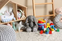 Different child toys on floor. Against color wall royalty free stock photography
