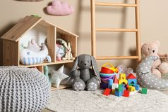 Different child toys on floor. Against color wall stock photography