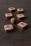 Different chocolate candies on a wooden table. Different candies on a wooden table viewed from above Royalty Free Stock Photos