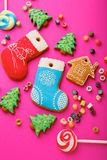 Different Christmas cookies and mixed multicolored candy. On pink background Stock Photography