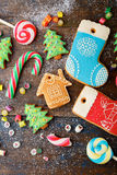 Different Christmas Gingerbread cookies and mixed sweet candy Royalty Free Stock Photos