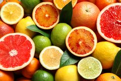 Different citrus fruits as background. Top view royalty free stock photography
