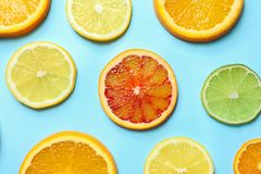 Different citrus fruits on color background stock photography