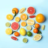 Different citrus fruits on color background. Flat lay royalty free stock photography
