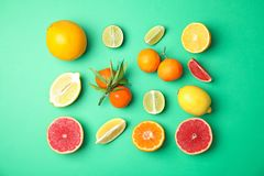 Different citrus fruits on color background. Flat lay stock photo