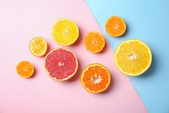 Different citrus fruits on color background. Flat lay royalty free stock photo