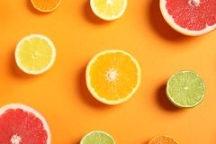 Different citrus fruits on color background royalty free stock photo