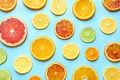 Different citrus fruits on color background royalty free stock photography