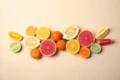 Different citrus fruits on color background. Top view royalty free stock photos
