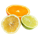 Different citrus fruits over the white background Stock Image