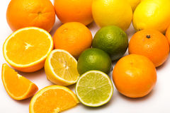 Different citrus fruits over the white background Stock Photography