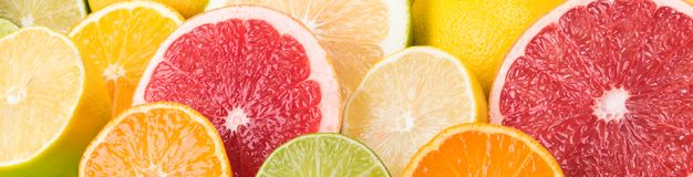 Different citrus fruits view from above. Bright background royalty free stock images