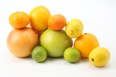 Different citrus fruits on white background. The different citrus fruits on white background stock photography