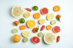 Different citrus fruits on white background. Flat lay royalty free stock photography