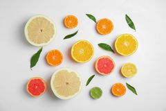 Different citrus fruits on white background. Flat lay royalty free stock photos