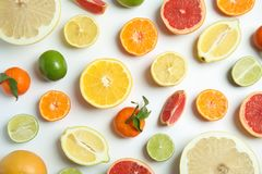 Different citrus fruits on white background. Flat lay stock photography