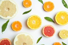 Different citrus fruits on white background. Flat lay royalty free stock image