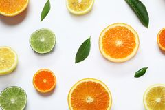 Different citrus fruits on white background. Top view stock images