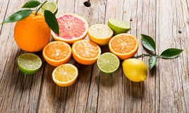 Different citrus fruits on wood Stock Photography
