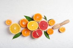 Different citrus fruits on wooden background. Flat lay royalty free stock images