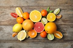 Different citrus fruits on wooden background. Top view royalty free stock image