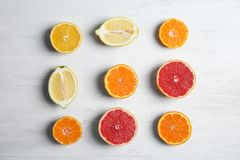 Different citrus fruits on wooden background. Flat lay royalty free stock photos