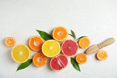 Different citrus fruits on wooden background. Flat lay stock images