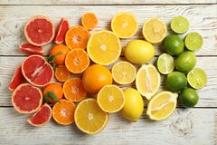 Different citrus fruits on wooden background. Top view royalty free stock photography