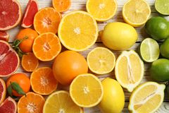 Different citrus fruits on wooden background. Top view stock photography