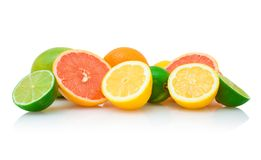 Different citruses. Mandarine (orange), lemon, grapefruit and lime halves together isolated on white with reflection Royalty Free Stock Image
