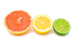 Different citruses. Halves of a grapefruit, lemon and lime placed as citrus traffic lights Stock Image