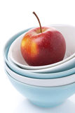 Different clean bowl and fresh red apple, isolated Royalty Free Stock Photo