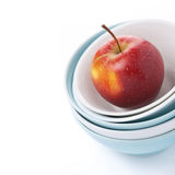 Different clean bowl and red apple, close-up, isolated Royalty Free Stock Photos