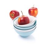 Different clean bowl and red apples, isolated Royalty Free Stock Photos