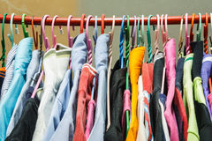 Different cloth. Many clothes on clothes-hanger Stock Photos