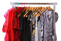 Different clothes on hangers Stock Photos