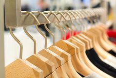 Different clothes on hangers close up royalty free stock images