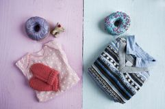 Different clothes for newborns with donuts Royalty Free Stock Images